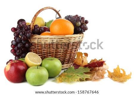Different fruits with basket and yellow leaves isolated on white - stock photo