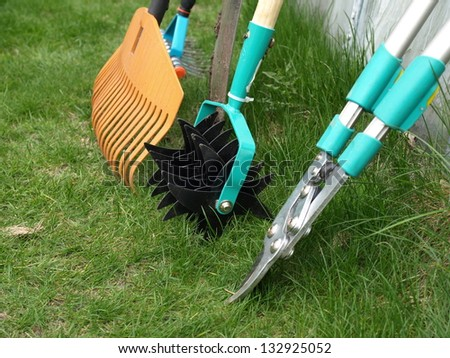 Different garden tools necessary for garden works - stock photo