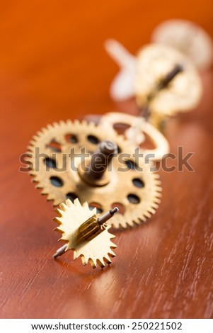 Different gears on the table in a row - stock photo