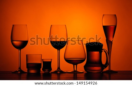 different glasses of alcoholic drinks on a table