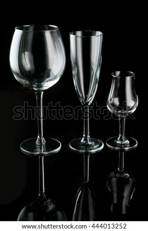 different glasses on a black background