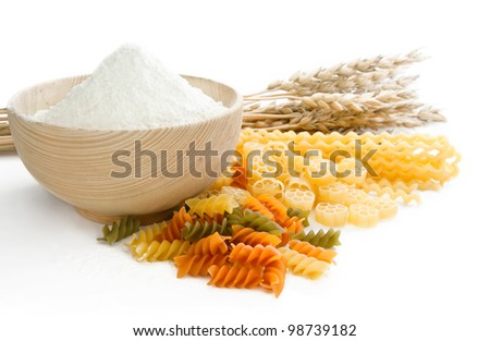 different grades of paste and flour in wooden bowl - stock photo