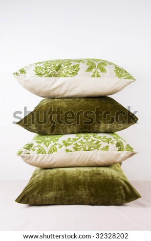 Different green pillows stacked up - stock photo