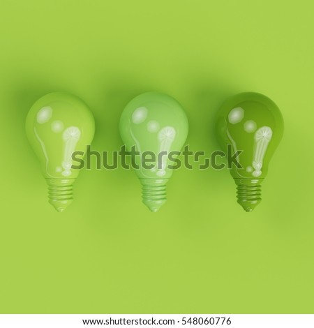 Different green shade pantone light bulbs on green background. minimal concept.