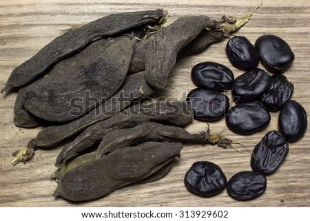 different haricot beans on the wooden table with copy space - stock photo
