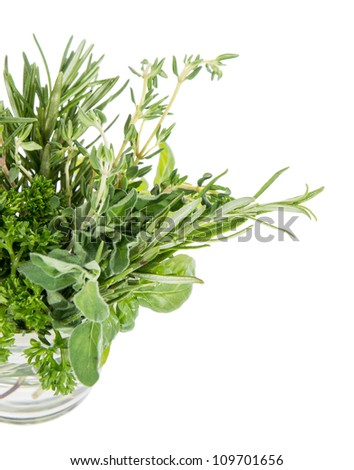 Different Herbs in a glass isolated on white background