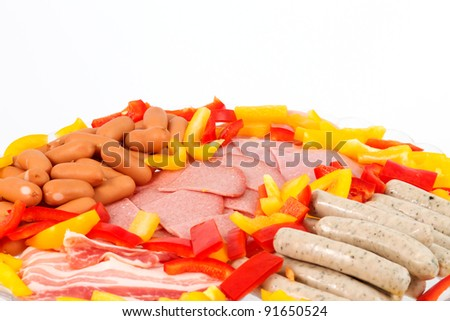 Different ingredients in front of a white background