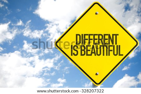 Different is Beautiful sign with sky background