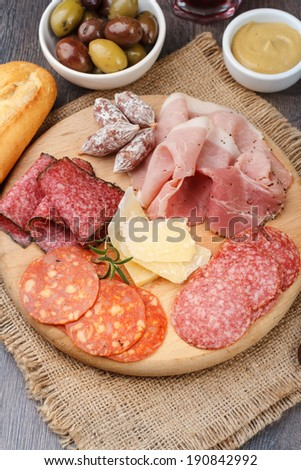 Different Italian ham and salami - stock photo