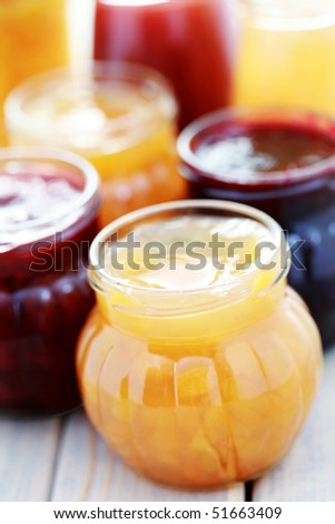 different jars full of fruity jam - food and drink - stock photo