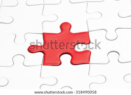 Different Jigsaw Puzzle Piece Red And White Color Business Concept For Completing The Final