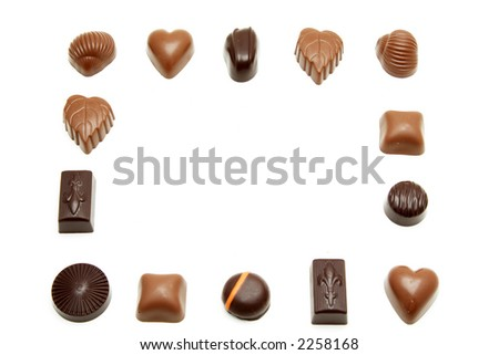 Different kind of chocolates forming a border frame