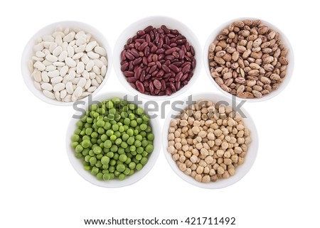 Different kind organic products of  vegetables, pulses, bean, peas and chickpeas in white dishes isolated on white background - stock photo