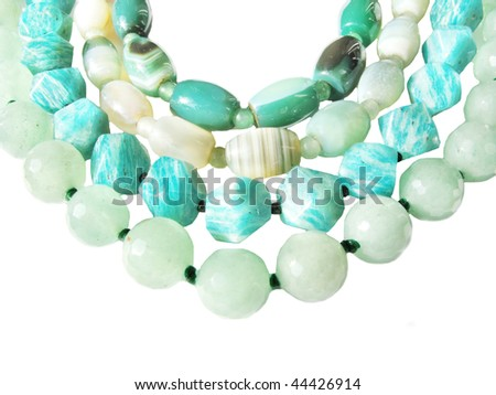 different kinds of beads green color - stock photo