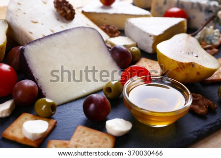 Different kinds of cheese closeup - stock photo