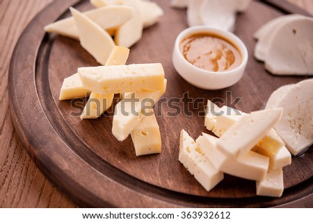 different kinds of cheese on a plate - stock photo