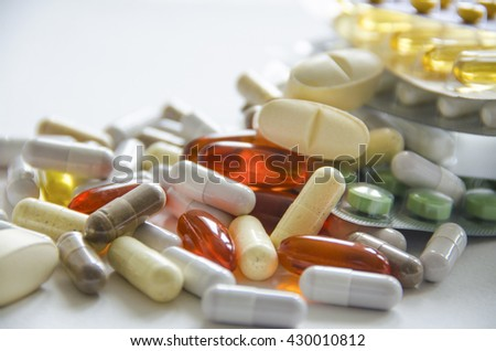 Different kinds of medicines scattered on the table