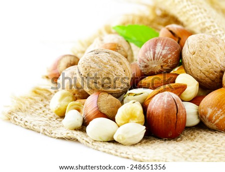 different kinds of nuts (almonds, walnuts, hazelnuts, pistachios) - stock photo