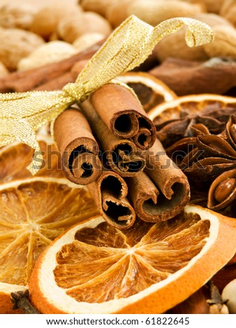 Different kinds of nuts, spices and dried oranges. Shallow dof. - stock photo