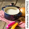Different kinds of soups - sprinach soup, french onion cream-soup and carrot cream-soup on the table - stock photo