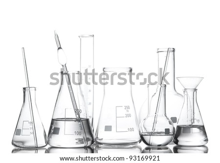 Different laboratory glassware with water and empty with reflection isolated on white - stock photo