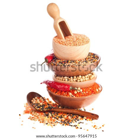 Different lentils, soybeans and red chilli peppers - stock photo