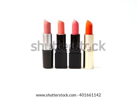 Different lipsticks on white background - stock photo