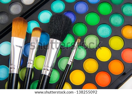 Different makeup brushes and make-up eye shadows