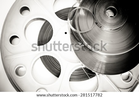 Different 35mm movie detail black and white background - stock photo