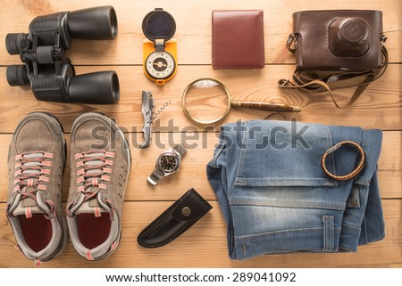 Different objects for traveling on wooden background  - stock photo