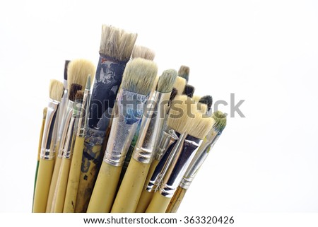 Different paintbrushes on white background - stock photo