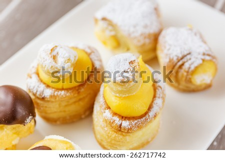 Different pastry cream or chocolate covered sugar forms. - stock photo