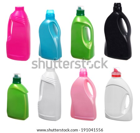 different plastic bottles of cleaning products on white - stock photo