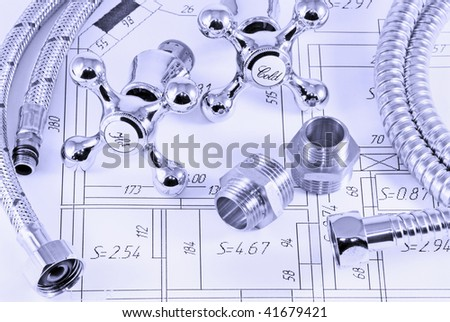 different plumbing and metal accessories on the layout of apartments - stock photo