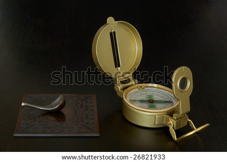 Different points of views: Chinese compass points south while Western compass points north - stock photo