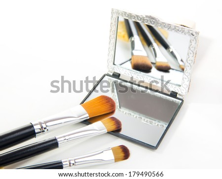 different professional cosmetic brushes on white background