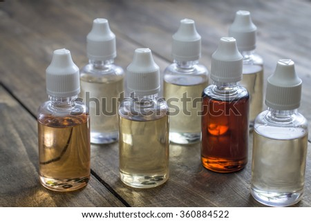Different re-fill bottles for e-cigarettes, close up