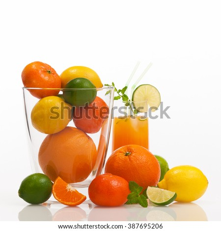 Different refreshing citrus fruits and fruit cocktail against white background; Cocktail ingredients; Vitamin suppliers; Fitness drink - stock photo