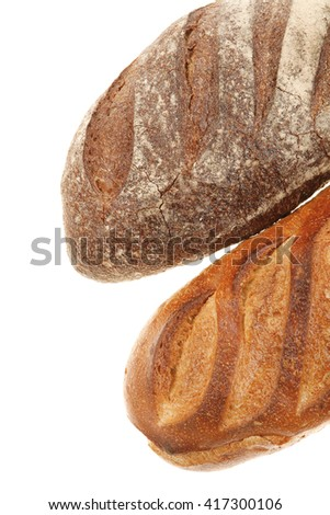 different rye and white flour fresh french bread loaf isolated on white background - stock photo