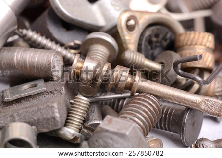 Different screws and other parts, close up - stock photo