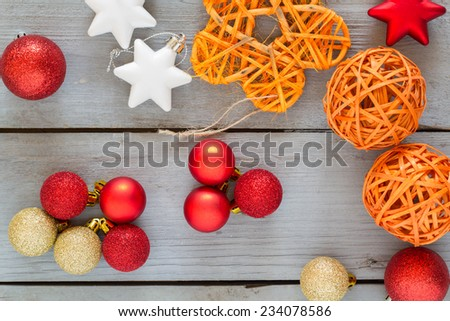 Different shaped christmas ornaments on a grey wooden table. - stock photo