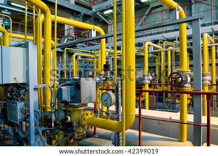 different size and shaped pipes at a power plant - stock photo
