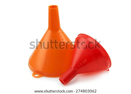 Different size of red plastic funnel isolated on white - stock photo