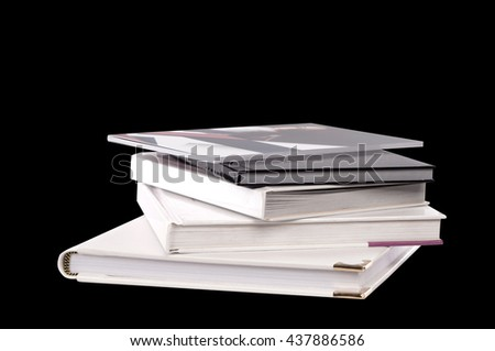 different sizes albums and books on a black background - stock photo
