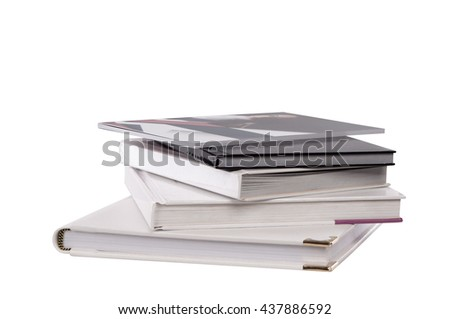 different sizes albums and books on a white background
