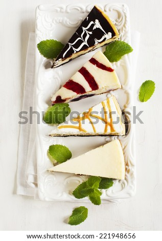 Different slices of cheesecake - stock photo