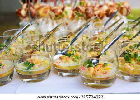 Different snacks as finger food on wedding table - stock photo