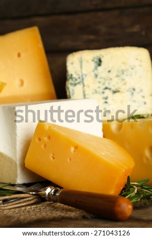 Different sort of cheese on wicker tray, closeup - stock photo