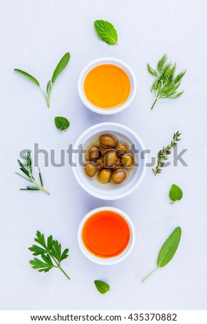 Different sorts of cooking oil,olive oil flavored and Sesame oil with spices  set up with marble background concept for international cuisine. - stock photo