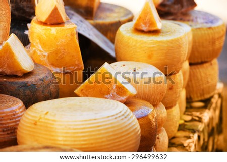 Different sorts of delicious italian cheeses on the market - stock photo